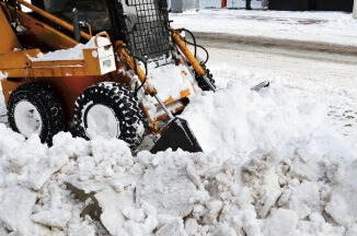 Front end loader for snow removal