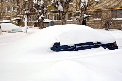 Car buried in snow in Lynn MA